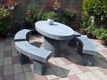 Canto bonito do assento da pedra do jardim Fotos de Stock