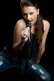Canto da mulher da música Imagem de Stock