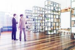Canto de escritório de madeira, sofá azul, cartaz tonificado Imagem de Stock
