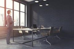 Canto de escritório preto do espaço aberto do tijolo tonificado Imagens de Stock Royalty Free