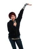 Canto teenager della ragazza con un microfono Immagine Stock