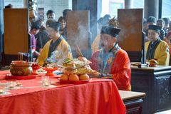 CANTON, CHINA – CIRCA FEBRUARY 2019: The taoist priests hold a requiem for the dead. Chinese New Year memorial service hold in the taoist temple in royalty free stock photo