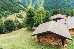 Alps, Switzerland. Canton of Valais, Switzerland. Swiss Alps, small house with firewood royalty free stock photo