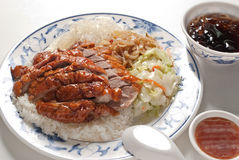 Cantonese barbecued Siu Mei Rice. Rice, roast duck, fried cabbage, and sweet grass jelly Stock Photography