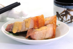 Cantonese Crispy Pork. A dish of Cantonese crispy pork with a mustard sauce dressing Stock Image