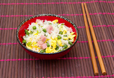 Cantonese rice on bamboo tablecloth Stock Photo