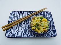 Cantonese rice served in a cup on white background stock image