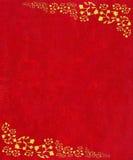 Cantos do rolo do ouro no fundo textured vermelho Fotografia de Stock Royalty Free