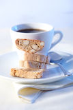 Cantucci cakes. And cup of coffee on background Royalty Free Stock Photos