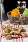 Cantucci e Vin Santo. A composition with the typical tuscan buscuits called cantucci and a glass filled with vin santo (holy wine), a tuscan dessert wine Royalty Free Stock Images
