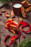 Cantucci with milk on wooden rustic table. Christmas or New Year food concept. Cantucci with milk on wooden rustic table. Close up.  Christmas or New Year food stock photos