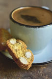 Cantuccini and coffee in a blue cup.Tinted photo. Stock Photography