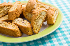 Cantuccini cookies on checkered tablecloth. The cantuccini cookies on checkered tablecloth Stock Image
