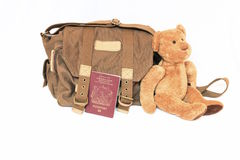 Canvas bag, British passport and teddy bear. Signifying travel and travel with children Royalty Free Stock Photo