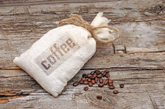 Canvas bag with coffee beans Royalty Free Stock Photo