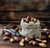 Canvas bag with nuts on a wooden table stock photography
