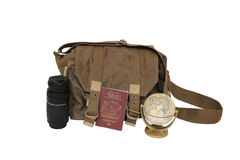 Canvas bag, zoom lens, UK passport and globe. (adventure travel; exploring; travel photography Stock Photo