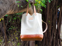 Canvas Bags hang on banyan branch Royalty Free Stock Image