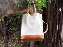 Canvas Bags hang on banyan branch Royalty Free Stock Image