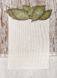 Canvas, bay leaves and linen fabric on the old wood Royalty Free Stock Photos