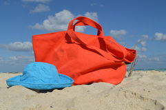 Canvas Beach Bag and Hat in the Sand Stock Photography