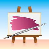 Canvas board and color brush Stock Images