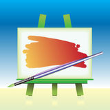 The canvas board and color brush Royalty Free Stock Images