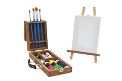 Canvas with brushes and acrylic briefcase Stock Photo