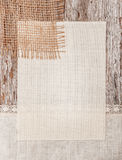 Canvas, burlap and linen fabric on the old wood Royalty Free Stock Photos