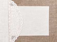Canvas card on burlap with lacy and linen cloth Royalty Free Stock Photography