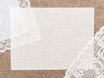 Canvas card on burlap with lacy and linen cloth Royalty Free Stock Image