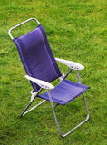 Canvas chair on grass Stock Photo