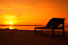 Canvas chair during the sunset. Sunset in Asia at the island Gili Air in Indonesia Royalty Free Stock Images