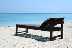 Canvas chair on tropical beach. A single chair on a tropical beach in Asia Royalty Free Stock Image