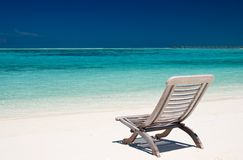 Canvas chair on tropical beach stock photography
