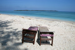 Canvas chairs on tropical beach Stock Photos