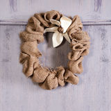 Canvas christmas wreath with decorations on blue door Royalty Free Stock Images
