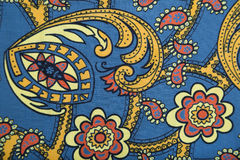 Canvas fabric with multicolored floral paisley pattern. Canvas fabric with multicolored bright floral paisley pattern in red, blue, yellow, orange colors Royalty Free Stock Photography