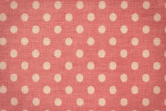 Canvas fabric texture. Pink canvas with white peas Royalty Free Stock Photo