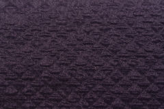 Canvas fabric texture. Rustic canvas fabric texture in aubergine color and  a diamond pattern Stock Images