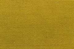 Canvas fabric texture. Rustic canvas fabric texture in mustard color Stock Photo
