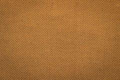 Canvas fabric texture. Rustic canvas fabric texture in orange color Stock Image
