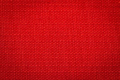 Canvas fabric texture. Rustic canvas fabric texture in red color. Square shape Royalty Free Stock Photo