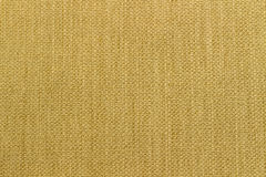 Canvas fabric texture. Rustic canvas fabric texture in Yellow color Royalty Free Stock Photo