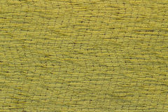 Canvas fabric texture. Rustic canvas fabric texture in yellow color and wave pattern Royalty Free Stock Photo