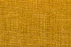 Canvas fabric texture. Rustic canvas fabric texture in Yellow Orange color Royalty Free Stock Photos