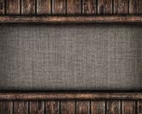 Canvas framed by old wooden planks Royalty Free Stock Images