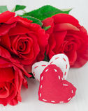 Canvas handmade hearts and red roses for Valentines day Stock Photos