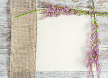 Canvas with heather and sacking ribbon Stock Image