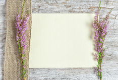 Canvas with heather and sacking ribbon Stock Photo